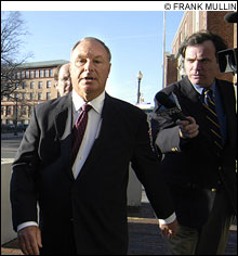MOVING TARGET: Urciuoli (center) takes part in the Rhode Island ritual of another scandal-related arraignment.